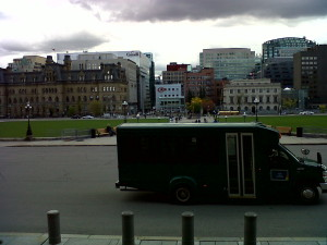 looking south from Centre Block, showing green bus & city view